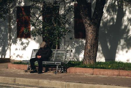 typical Sardinia senior man taking in a small village - siesta in italy