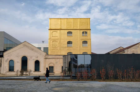 Milan, ITALY FEB 2019 - Fondzione Prada museum - golden yellow warm building in the new square Adriano Olivetti in the south of town