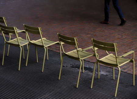 empty chairs with man legs walking - failure and refuse concept 写真素材