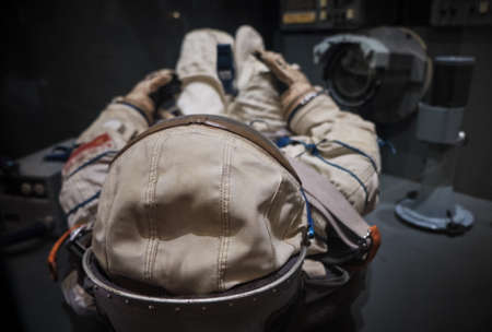 cosmonaut or astronaut or spaceman suit and helmet on board the spaceship reasy for landing or space operations