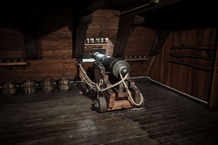 interior view of Cannons At The Deck and Cannon Balls plus windows on old galleon with ropes
