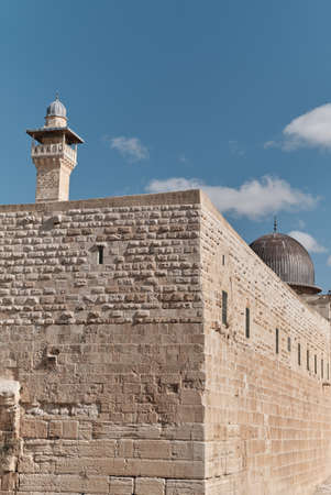 Wall of Jerusalem's Old City and clear blue sky with clouds in a sunny day, Israel