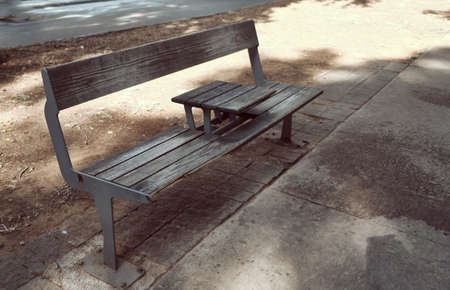 public bench with table in the center