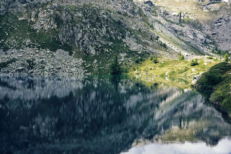 lake with mountain reflection in the water - Champorcher - Aosta - italy - peace and relax concept