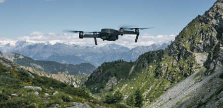 Close up image of drone flying towards mountains in a sunny day Imagens