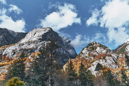 panorama view of mountain and multicolor woods, in autumn season in Val di Mello, Val Masino, Italy - lombardy Stock fotó