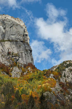 Mountain multicolor woods, in autumn season lake in Val di Mello, Val Masino, Italy - lombardy