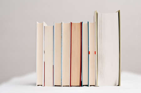 Row of books from the page side Stock Photo