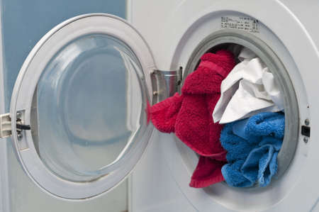 Open Washing machine with white, red and blue cloths Stock Photo - 18229145