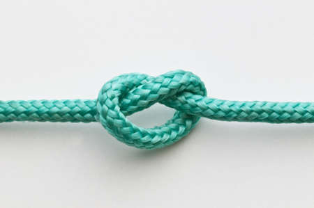 string together: A simple knot on a green rope