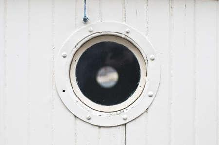 White porthole on a sail boat Stock Photo