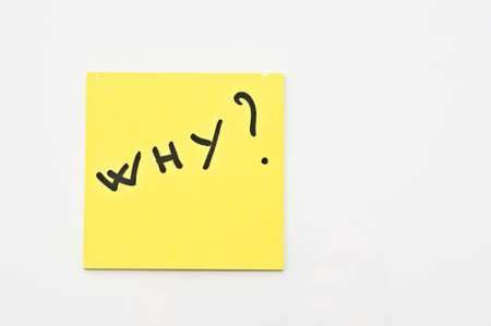 Yellow square Post it with  Why ? written on it Stock Photo