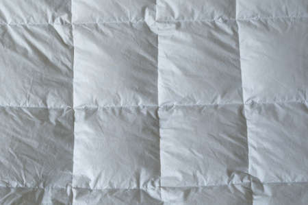 Detail of down comforter with white squares Imagens - 18880817