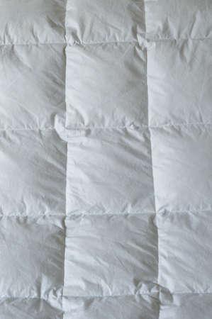 edred�n: Detalle de un edred?n con cuadrados blancos