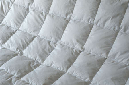 Detail of down comforter with white squares