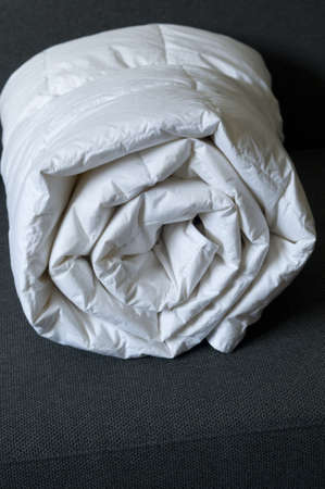 Detail of a rolled white down comforter Imagens - 18880830