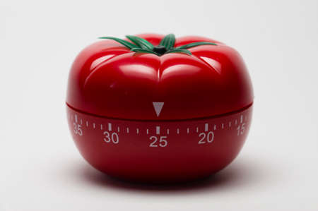 Pomodoro (tomato) technique is a study method that helps avoiding procrastination using a kitchen timer Stock Photo
