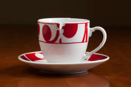 put together: European style white and red broken coffee cup put together