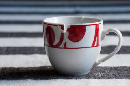 put: European style white and red broken coffee cup put together