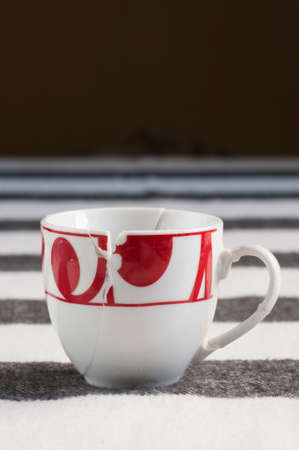 put on: European style white and red broken coffee cup put together