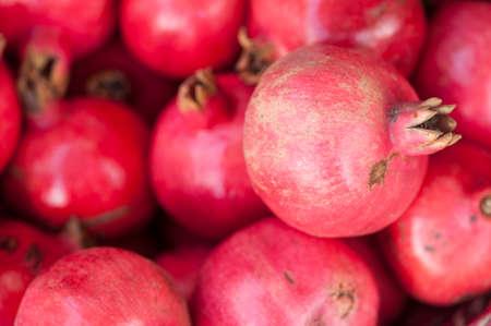granatum: pomegranate, Punica granatum, fruits on display at market