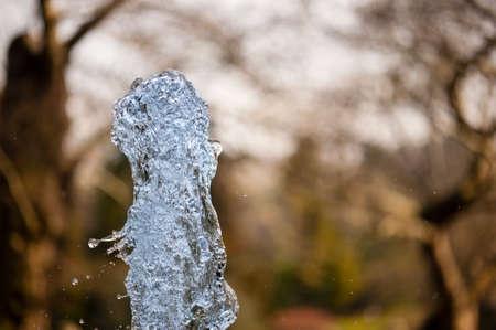 gush: Close up of ornamental fountain water gush.