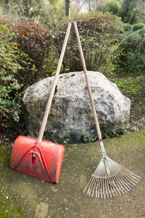 Shovel and rake tools for cleaning a garden Stock Photo