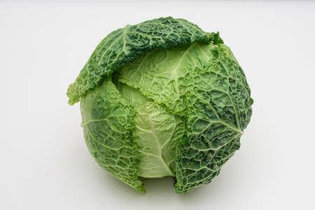 Green savoy cabbage on white background Stock Photo