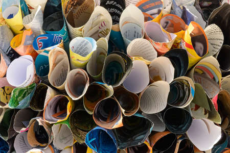 Recycled Ornamental object made of rolls of magazine paper pages.