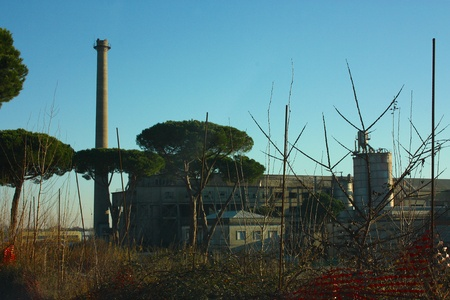 old abandoned factory and its chimney for the discharge of gas Banco de Imagens