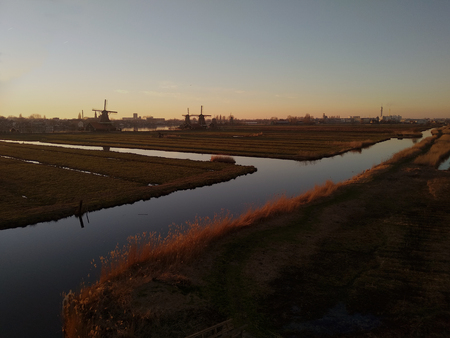 zaanse schans at sunset time. typical windmills immersed in a magical atmosphere