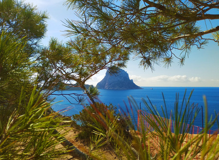 summer comes, ready for the holidays in the unspoiled nature of the Balearic islands. to discover ibiza and its wonders, like the islet of Es Vedra Stock fotó