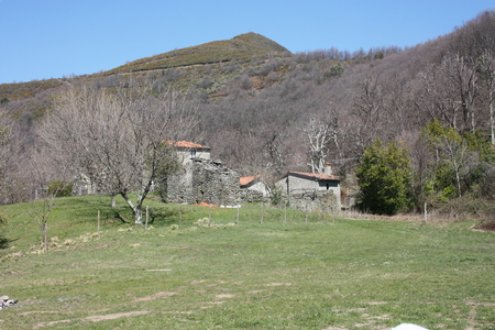 small house in the mountains abandoned in a large green clearing on the Apuan Alps in Tuscany, Tuscan Apennines