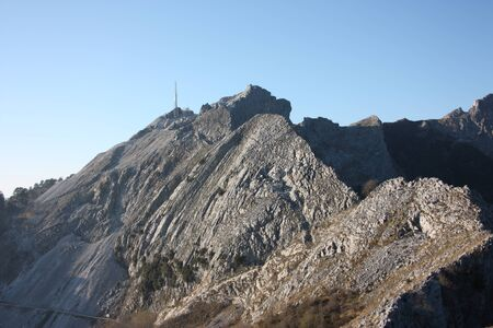 one side of the peaks of the mountains of the Tuscan Apuan Alps in Montignoso. Rocky Apennines on a summer day Banco de Imagens