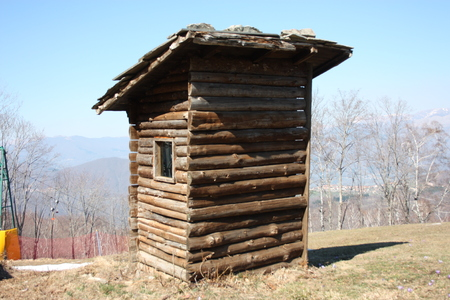 woodshed in the mountains or storage room built in logs to store things