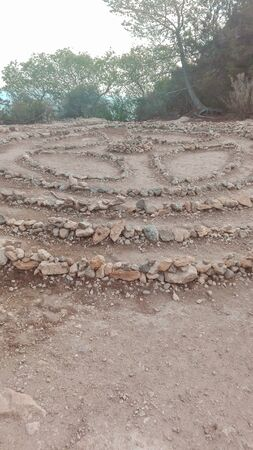 magic stones of the hippies, put in a circle in shamanic vortices, domino effect created with earth and boulders for Ibizan rituals in Spain Archivio Fotografico