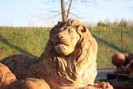 gigantic representation of the king of the forest that is a lion with a long mane created entirely in terracotta for exhibitions and gardens in craftsmanship