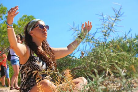 summer meditation of a caucasian girl between the wild and dry nature in ibiza