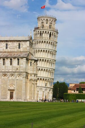 the monument of the leaning tower of Pisa built in marble in piazza dei miracoli in tuscany