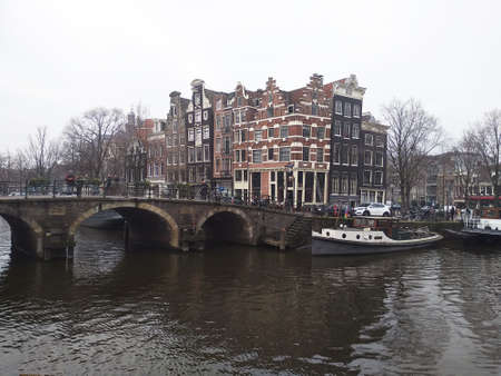 romantic Dutch canals of Amsterdam on a gray day of winter haze