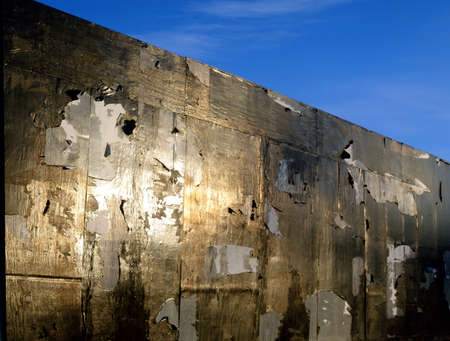 degradation: wall with golden highlights and background of blue sky
