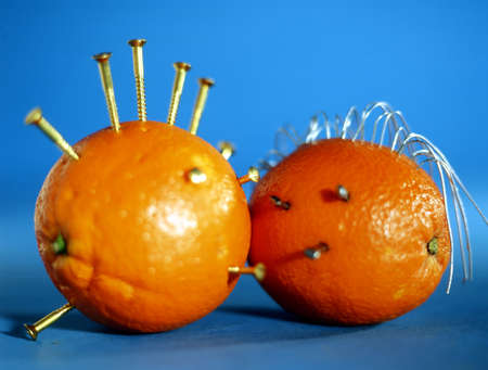 screwed: two oranges with screws screwed that look like faces