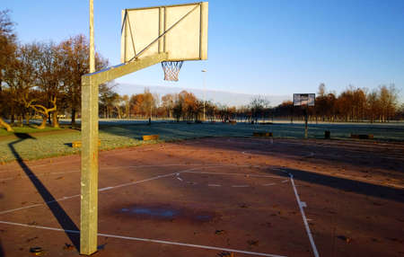 Basketball court in the park wilderness autumn winter Stock Photo