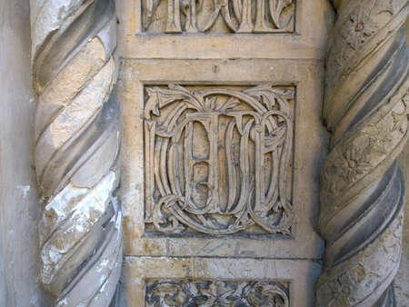 carmine: detail of the frieze latelare door of the church of Santa Maria del Carmine in Milan Brera Stock Photo
