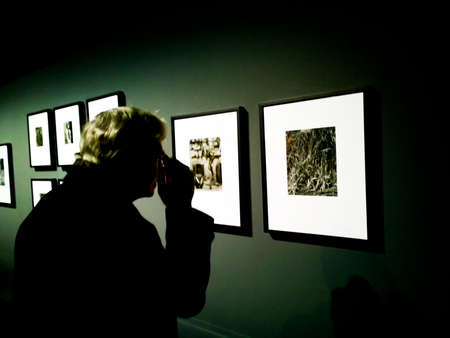 observes: A visitor observes a picture at Cartier Bresson Exibition in MILAN from 11 th November 2015to 7th of February 2016 CARTIER BESSON e gli altri