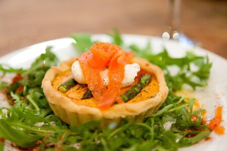A delicious fresh summery starter Smoked Salmon and asparagus tart photo