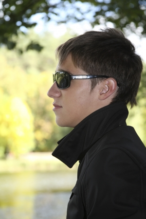 profile of a man in sunglasses, autumn, park