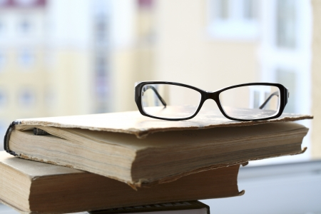 modern glasses and old book Stock Photo