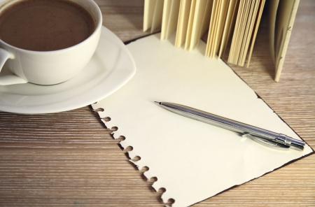 image of cup of coffee, pencil and blank of paper