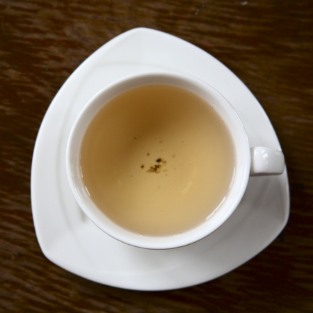 image of a white cup with green tea